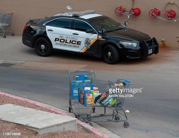 Shopping cart containing food sits outside the Cielo Vista Mall Wal-Mart where a shooting left 20 people dead in El Paso, Texas, on August 4, 2019. -...