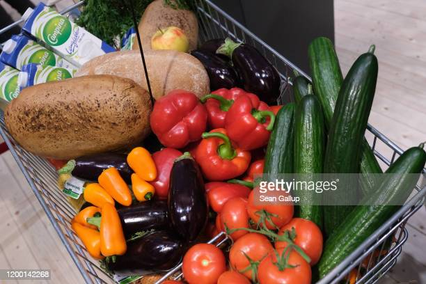 Shopping cart filled with fresh vegetables, bread and milk stands on display at the Green Week agricultural trade fair on January 17, 2020 in Berlin,...