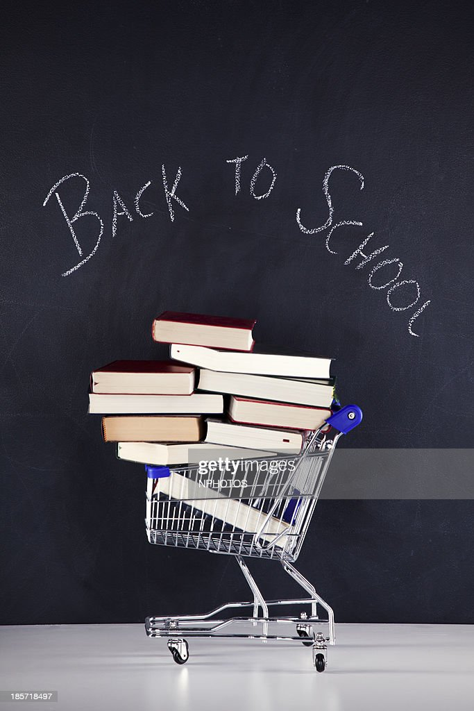 Shopping cart full of books : Stock Photo