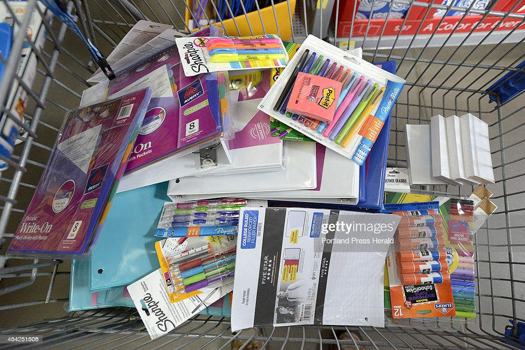 Shopping cart full of school supplies as parents and their children shop for school supplies at Walmart in Scarborough.