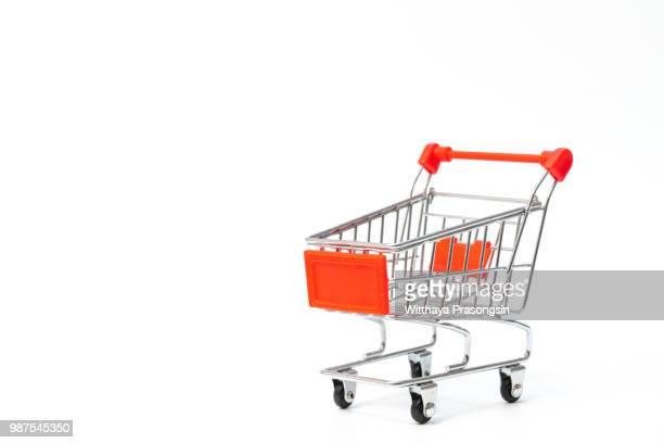 a shopping cart isolated on white - mercado espaço de venda no varejo - fotografias e filmes do acervo