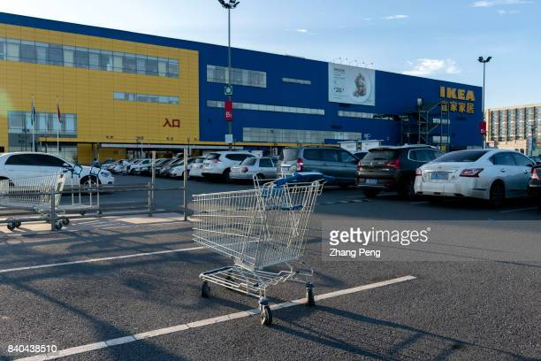 A shopping cart on the parking lot outside an IKEA shop A financial report released by IKEA China on August 18th shows that IKEA still maintained two...