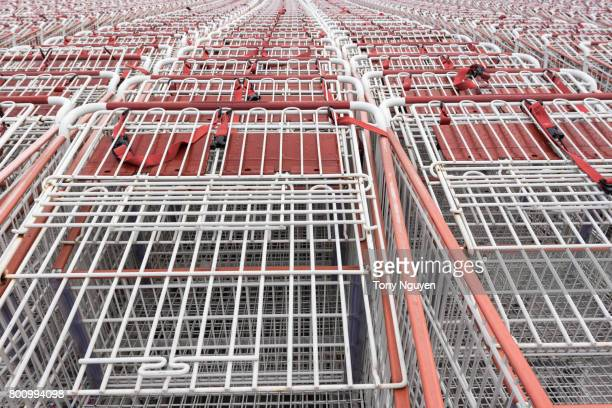 shopping cart (trolley) pattern in front of a supermarket, ready for customers to use. - adelaide market stock pictures, royalty-free photos & images