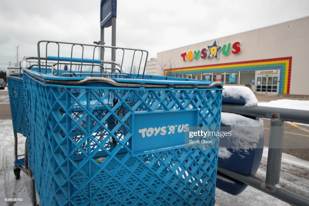 A shopping cart sits in the parking lot at a Toys 'R' Us store on January 24, 2018 in Highland Park, Illinois. The store is one of more than 180 Toys 'R' Us and Babies 'R' Us stores scheduled to close. The closings involve about one-fifth of the company's Toys 'R' Us and Babies 'R' Us U.S. store fleet. The company recently filed for bankruptcy protection.
