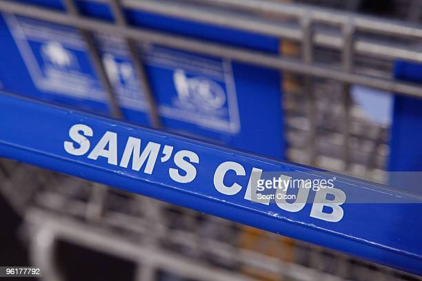 A shopping cart sits in the parking lot of a Sam's Club store January 12 2010 in Rolling Meadows Illinois WalMart Stores Inc the parent company of...