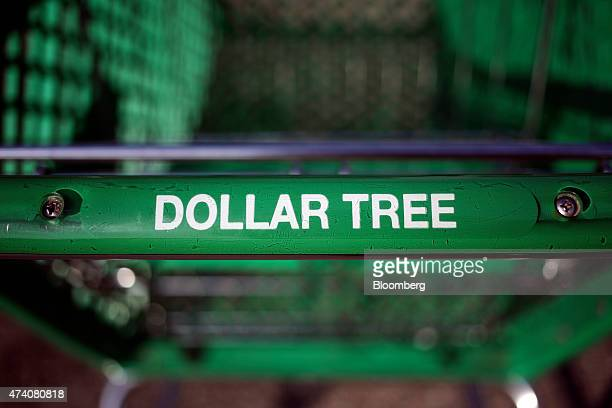 A shopping cart sits outside a Dollar Tree Inc store in Shelbyville Kentucky US on Friday May 15 2015 Dollar Tree is expected to release firstquarter...