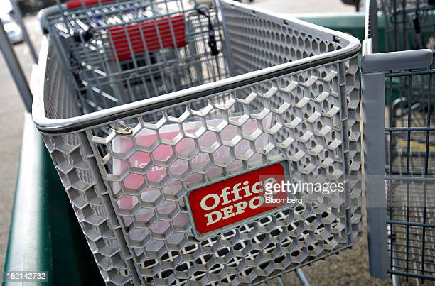 Shopping cart sits outside an Office Depot Inc. Store in Peoria, Illinois, U.S., on Tuesday, Feb. 19, 2013. Office Depot Inc. And OfficeMax Inc. Are...