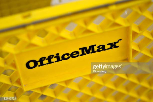 Shopping cart sits outside an OfficeMax Inc. Store in East Peoria, Illinois, U.S., on Tuesday, Feb. 19, 2013. Office Depot Inc. And OfficeMax Inc....