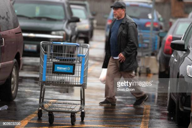 A shopping cart sits outside of a Walmart store on January 11 2018 in Chicago Illinois Walmart announced today it would use savings from the recently...