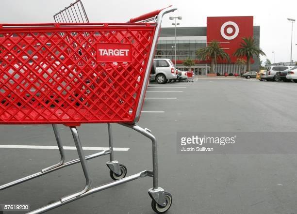 A shopping cart stands in the parking lot of a Target store May 15 2006 in Albany California Target announced a 12 percent rise in profit in its...