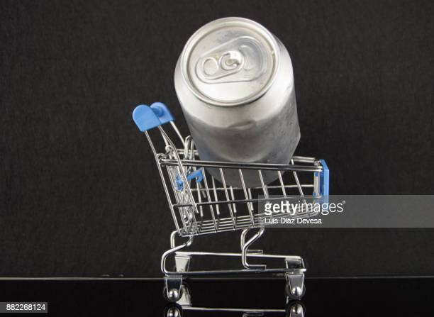 Shopping cart with a beer can