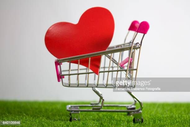 Shopping cart with a red heart