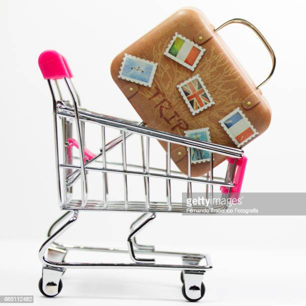 Shopping cart with a suitcase, luggage. Vacation and travel