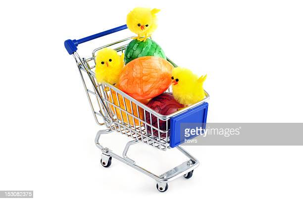 shopping cart with colored easter eggs and young chicken