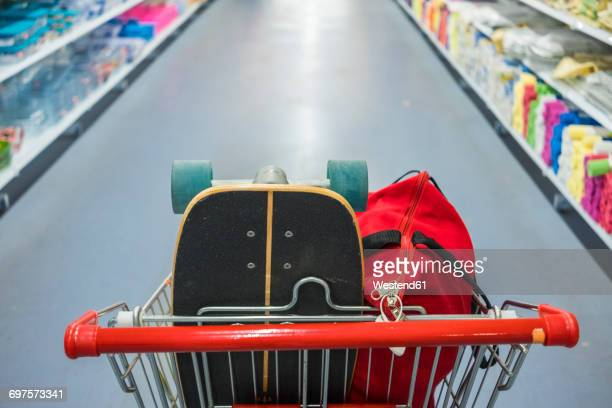 shopping cart with skateboard and bag - handle stock pictures, royalty-free photos & images