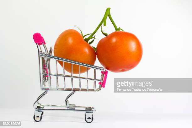 Shopping cart with two tomatoes