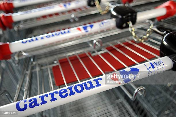 Shopping carts are lined up at a Carrefour supermarket in Paris France on Wednesday March 5 2008 Carrefour releases its annual earnings tomorrow