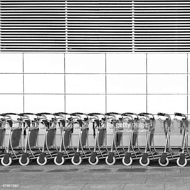 Shopping Carts Arranged In Row Against Wall
