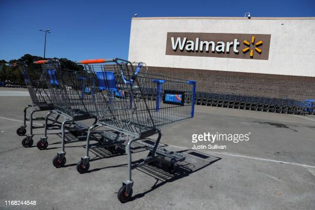 Shopping carts sit in front of a Walmart store on August 15, 2019 in Richmond, California. Walmart beat analyst expectations with second quarter...