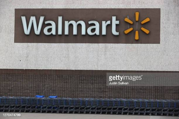 Shopping carts sit in front of a Walmart store on September 03, 2020 in Richmond, California. Walmart has announced plans to launch Walmart Plus...