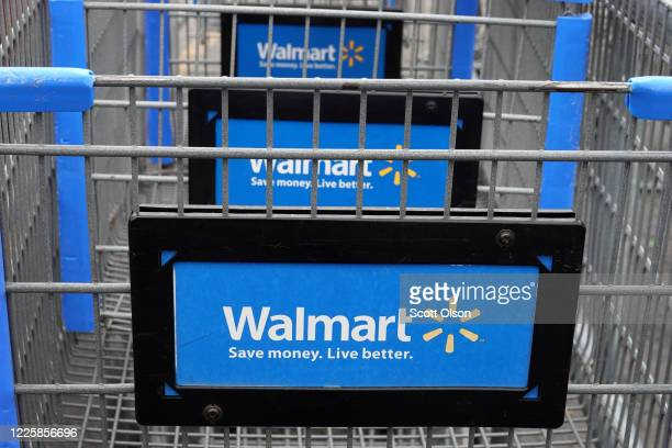 Shopping carts sit in the parking lot of a Walmart store on May 19, 2020 in Chicago, Illinois. Walmart reported a 74% increase in U.S. Online sales...