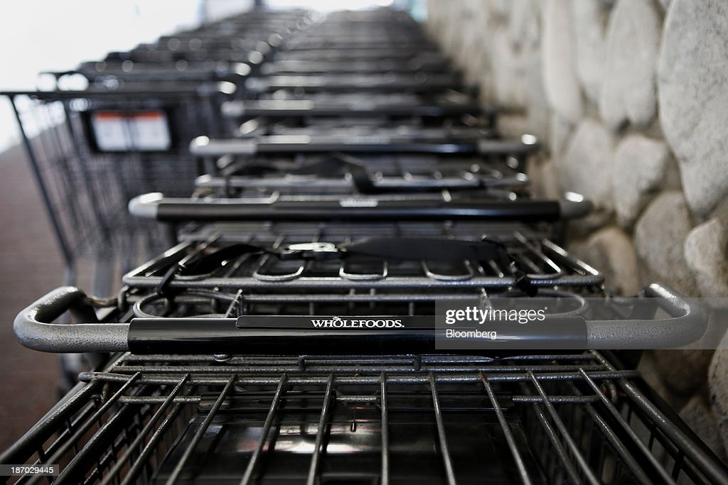 Shopping carts sit lined up outside of a Whole Foods Market Inc. location in Redondo Beach, California, U.S., on Tuesday, Nov. 5, 2013. Whole Foods Market Inc. is scheduled to release earnings figures on Nov. 6. Photographer: Patrick T. Fallon/Bloomberg via Getty Images