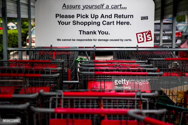 Shopping carts sit outside a BJ's Wholesale Club Holdings Inc location in Miami Florida US on Thursday May 17 2018 The warehouseclub chain which had...