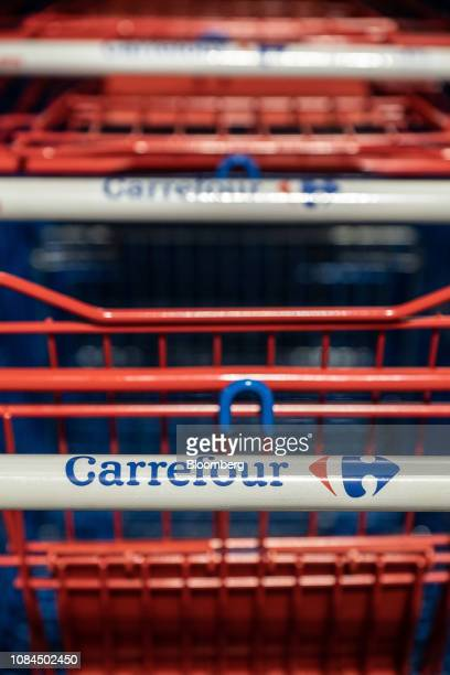 Shopping carts sit outside a Carrefour SA hypermarket store in Marseille France on Thursday Jan 17 2019Shares in French retailers...
