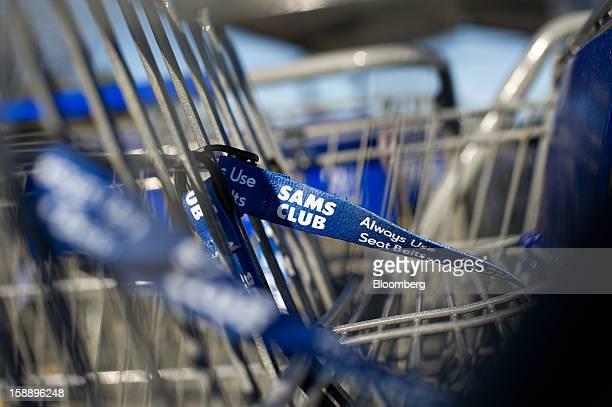 Shopping carts sit outside a Sam's Club store in Peoria Illinois US on Wednesday Jan 2 2013 The International Council of Shopping Centers is...