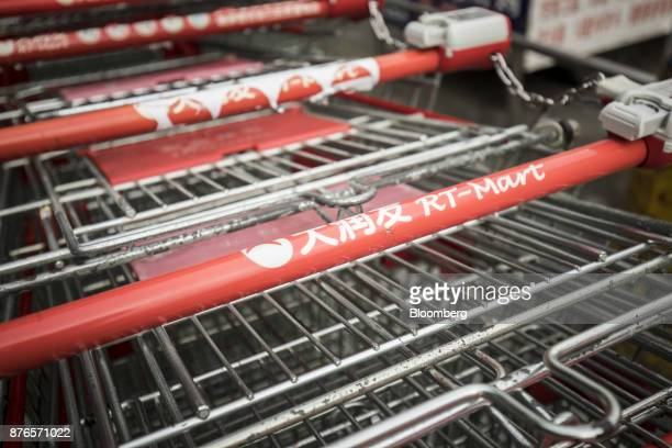 Shopping carts sit outside an RTMart hypermarket operated by Sun Art Retail Group Ltd in Shanghai China on Monday Nov 20 2017 Alibaba Group Holding...