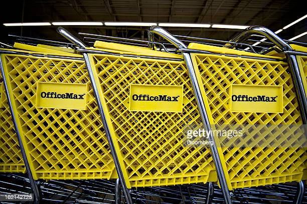 Shopping carts sits inside an OfficeMax Inc. Store in Peoria, Illinois, U.S., on Tuesday, Feb. 19, 2013. Office Depot Inc. And OfficeMax Inc. Are...