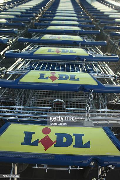 Shopping carts stand outside a Lidl discount grocery store on May 10 2016 in Berlin Germany German anticartel authorities announced yesterday they...