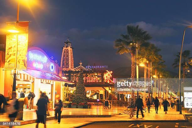 Shopping center along main road at Playa de Las Americas