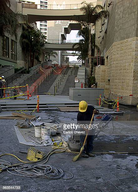 Shopping center on Highland Ave and Hollywood Blvd in Hollywood is one of two pro jests of developer Trizechahn labor cleans after a long day of work...