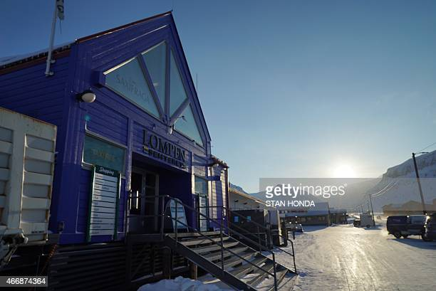 A shopping center on the main street of Longyearbyen Svalbard an archipeligo administered by Norway on March 19 2015 ahead of the March 20 total...