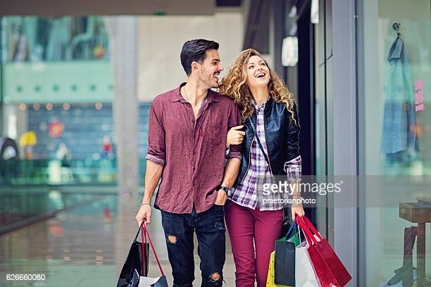 Shopping couple are walking in the Mall