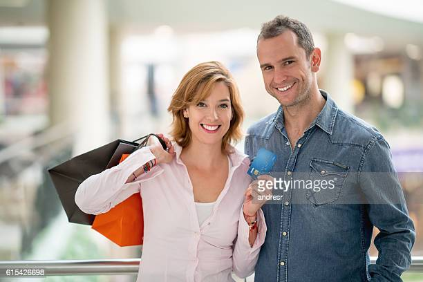 Shopping couple holding a credit card
