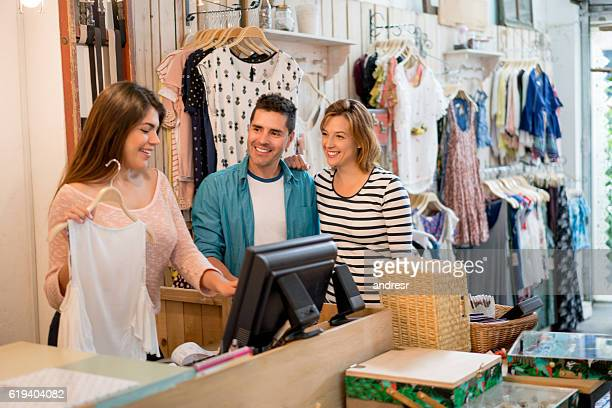 Shopping couple paying at the cashier
