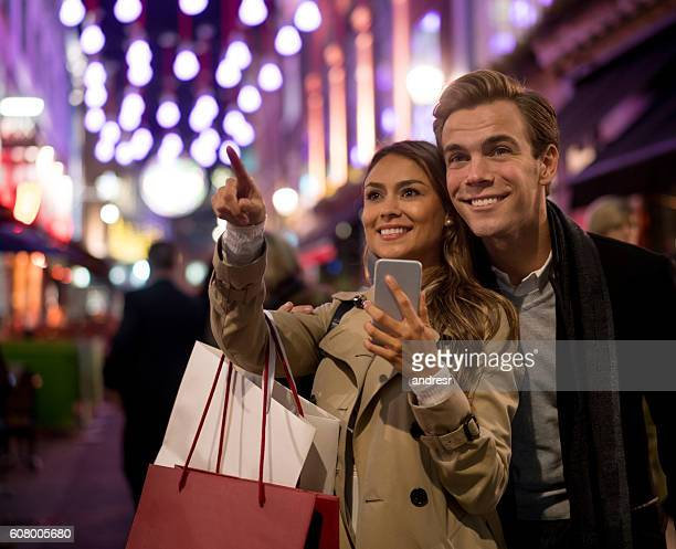 Shopping couple using app on a cell phone