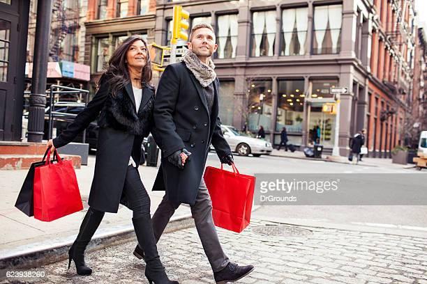 Shopping couple walking on street