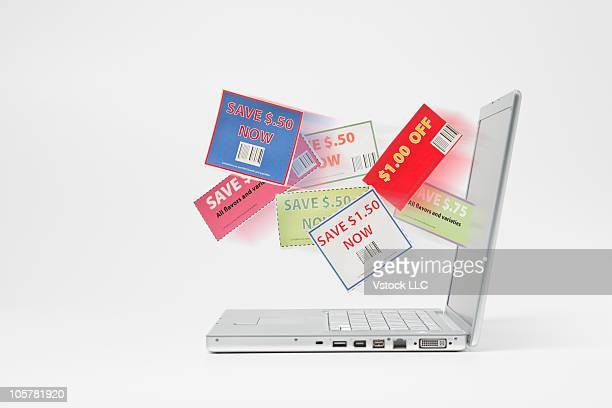 Shopping coupons coming out of laptop