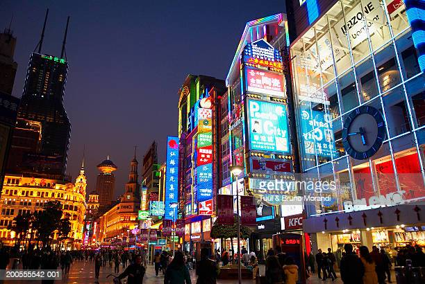 shopping district and neon signs, low angle view - shanghai billboard stock pictures, royalty-free photos & images
