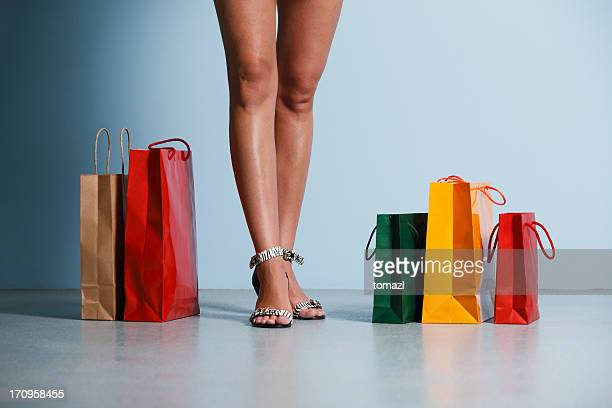shopping female legs with bags - exceed and excel stock pictures, royalty-free photos & images
