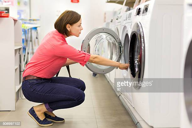 shopping for a washer and dryer - appliance stock pictures, royalty-free photos & images