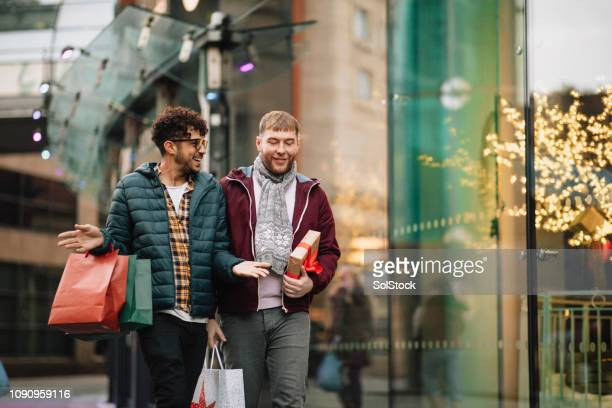 shopping for christmas - shop stock pictures, royalty-free photos & images