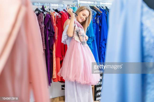shopping for elegant dress - prom dress stock pictures, royalty-free photos & images