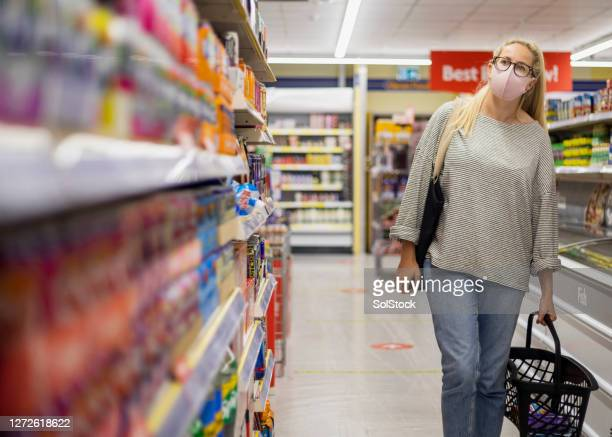 shopping for essentials - essential services stock pictures, royalty-free photos & images