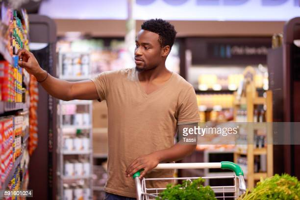 shopping for his favorite brands - man shopping stock pictures, royalty-free photos & images