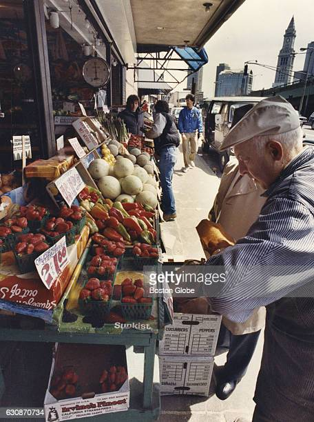 Shopping for produce at a North End market in Boston on April 25 1987 The Custom House tower can be seen in the background