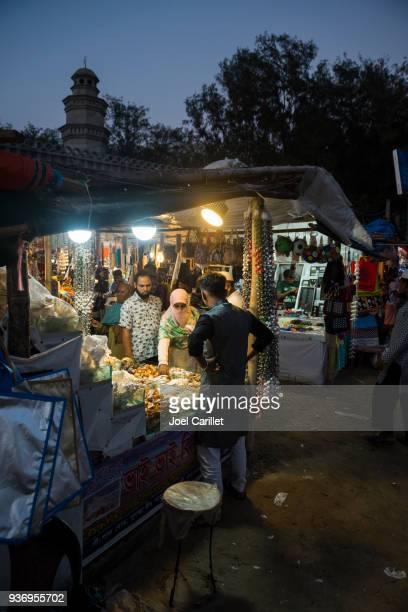 shopping for seashells in cox's bazar, bangladesh - muslim woman beach stock photos and pictures